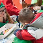 Evento Conad, bambino colora su un foglio